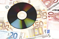 Money and cd Royalty Free Stock Photo