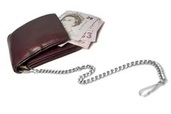 Money on a chain. A wallet on a chain with pounds inside. white background Stock Photography