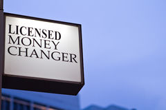 Money Changer. A licensed money changer in the city royalty free stock photos