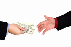 Money changing hands. Businessman exchanging money isolated on white royalty free stock photos