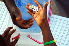 Money changing hands in africa Stock Photo
