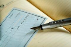 Money check. Horizontal image of money check and  pen Stock Image