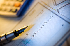 Money check and pen. Money check ,pen and calculator Royalty Free Stock Image