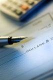 Money check and pen Royalty Free Stock Images