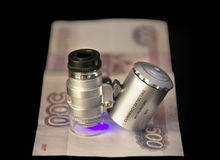Money. Checking banknotes pocket currency detector Royalty Free Stock Photography