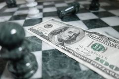 Money chess Royalty Free Stock Photo