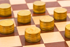 Money on chess board Stock Photography