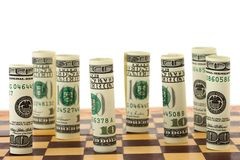 Money on chess board Royalty Free Stock Photos
