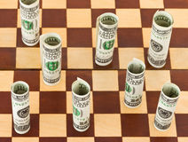 Money on chess board Stock Image