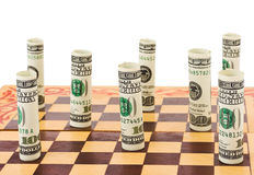 Money on chess board Royalty Free Stock Photo