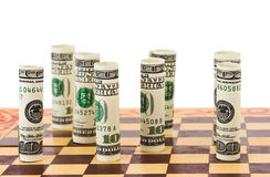 Money on chess board Royalty Free Stock Images