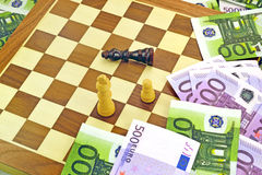 Money and chess Royalty Free Stock Images