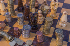 Money chess. Play life money chess black Royalty Free Stock Photography