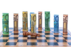 Money on a chessboard. Royalty Free Stock Photos