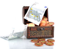 Money in a chest Stock Photo