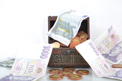 Money in a chest Royalty Free Stock Images