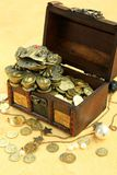 Money chest. Wooden chest with coins and ornaments stock image