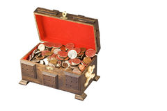 Money in a chest. Money in a wooden chest isolated on white Royalty Free Stock Image