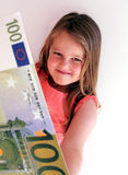 Money Child. Little Child holding 100 Euro in the hands Royalty Free Stock Images