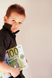 Money Child. Little Child holding 100 Euro in the hands Royalty Free Stock Photos