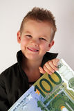 Money Child. Little Child holding 100 Euro in the hands Royalty Free Stock Photo