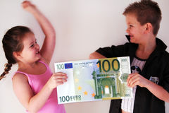 Money Child. Two Little Childs fighting about 100 Euro in the hands Stock Image
