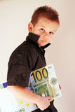 Money Child. Little Child holding 100 Euro in the hands Royalty Free Stock Photography