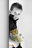 Money Child. Little Child holding 100 Euro in the hands Stock Images