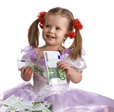 Money and child in dress. Stock Images
