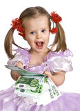 Money and child in dress. Royalty Free Stock Image