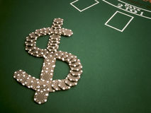 Money Chips. Poker chips arranged as a dollar sign.  On black jack table Stock Photo