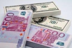 Money and chocolate Stock Photos