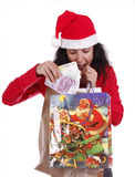 Money for christmas. Woman portraying father Christmas and taking money from the bag with a surprising expression Stock Image