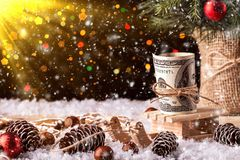 Money Christmas Gift with wooden sled. Christmas concept stock images