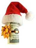 Money in a christmas hat. Money wrapped with a golden rope in a red santa hat Stock Photo