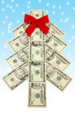 Money Christmas tree. And snow Stock Images