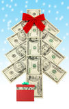 Money Christmas tree and gift. Money Christmas tree and snow, business concept Royalty Free Stock Photography