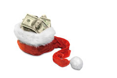 Money Christmas& Wealthy New Year-1. Santa's hat with dollar banknotes on a white background Stock Image