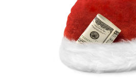 Money Christmas& Wealthy New Year-3. Santa's hat with dollar banknotes on a white background Royalty Free Stock Photography