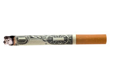 Money cigarette. Lit cigarette made from money isolated over a white background Stock Images