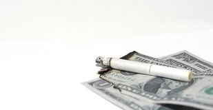 Money and cigarette Royalty Free Stock Image