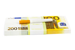 Money and cigarette Stock Image