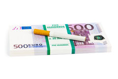 Money and cigarette Stock Photo