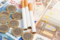 Money and cigarettes Stock Photo