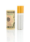 Money and cigarettes on a white background Stock Image