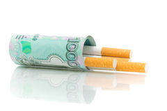 Money and cigarettes on a white background Royalty Free Stock Photo