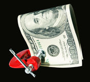 Money clamped in the clamp on the Black background Royalty Free Stock Photo