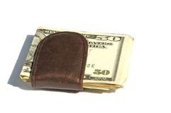 Money clip. A brown leather money clip with a fifty U.S dollar bill royalty free stock photos