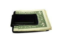 Money Clip. Black money clip with dollar bills Stock Photos