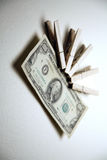 Money clipped with pegs Royalty Free Stock Photography